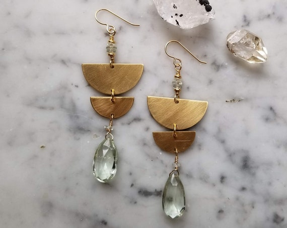 Green amethyst on graduated brass half moons