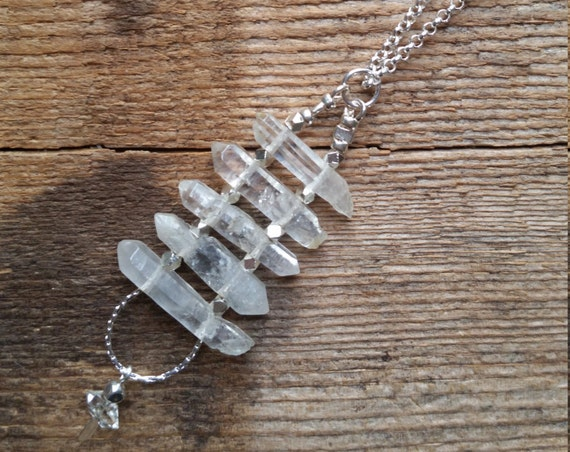 Double terminated quartz crystal ladder necklace with silver and a herkimer diamond