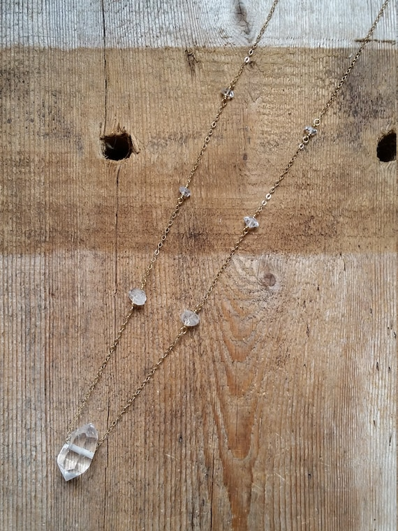 Long double terminated crystal necklace with herkimer diamonds on gold chain
