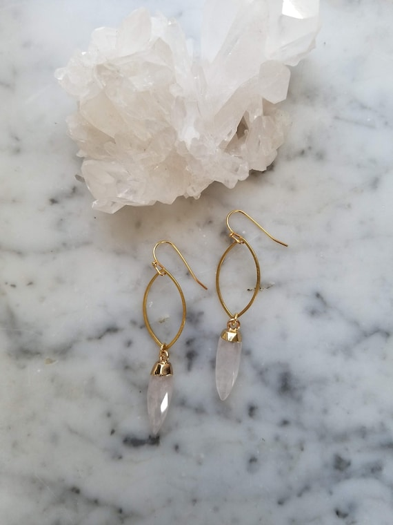 Brass marquis shape with faceted quartz crystal points