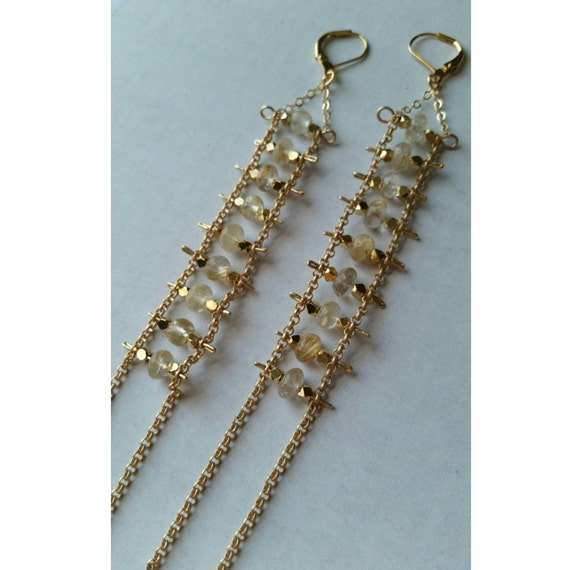 Golden rutilated quartz ladders on matte gold