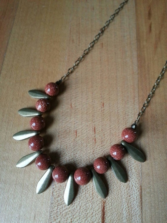 Goldstone with brass daggers on antique brass chain necklace