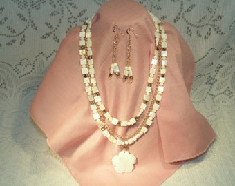 White Shell Necklace And Earrings With Gold Tone Chain And A Pretty Shell Pendant.