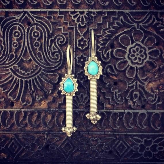 Silver Kuchi earrings.