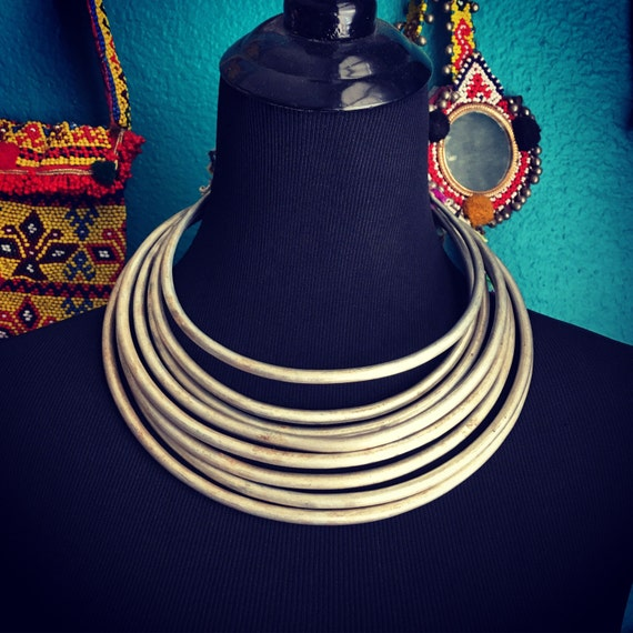 Base metal Hmong neckring with vintage fabric.