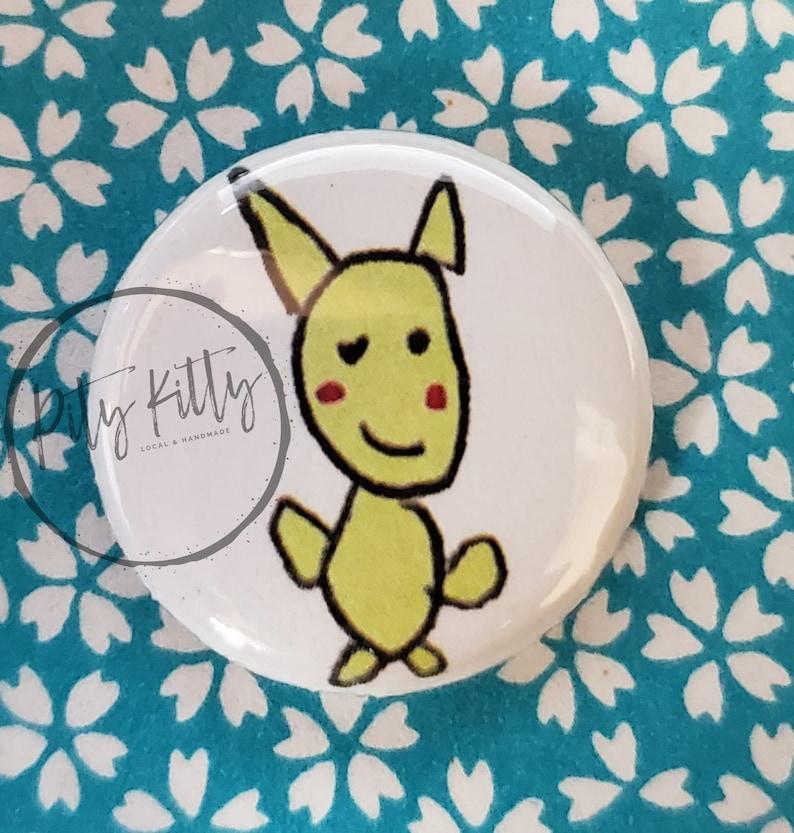 1 Button  Pikachu  Pokémon inspired image 0