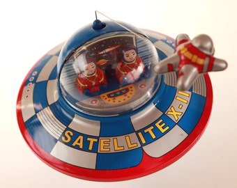 Space Ship With Astronaut in Space Clockwork
