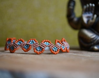 Handcrafted beaded macrame bracelet in blue and orange