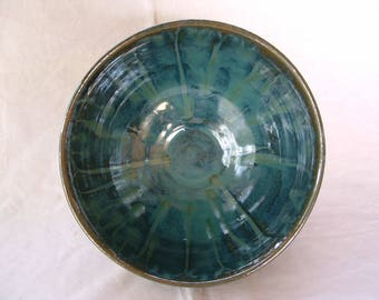 Large handmade stoneware bowl in greens and blues