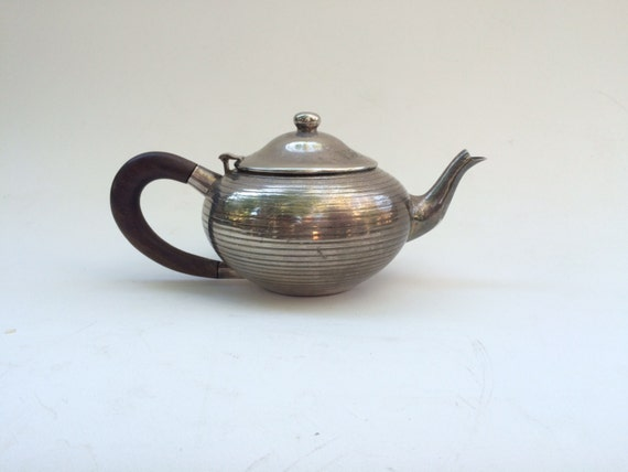 Vintage white enamel teapot with hinged