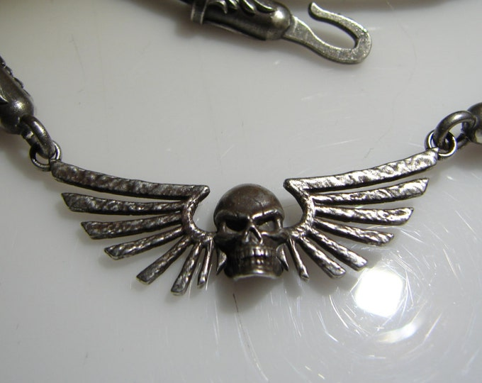 Gothic, Dark Angel skull and wing necklace. This custom design features a braided leather necklace with custom made findings.