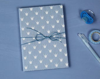 blue baby diary, baby diary with crowns, christening gift, ist a boy, baby diary with a lightblue cotton fabric, a baby is born, lightblue