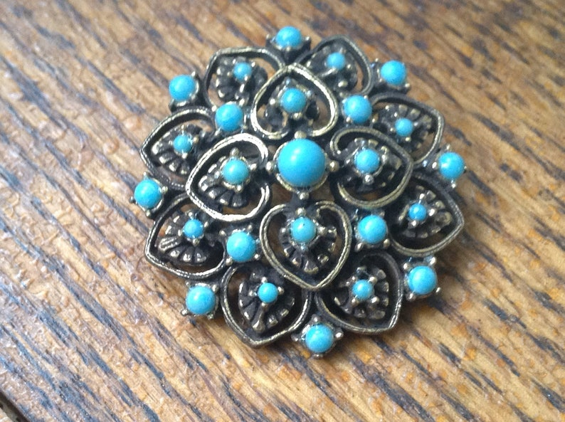 Blue and goldtone costume pin