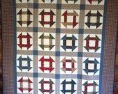 Churn Dash quilt. 57 x 80 inches. A traditional block pattern in old-fashioned colors.
