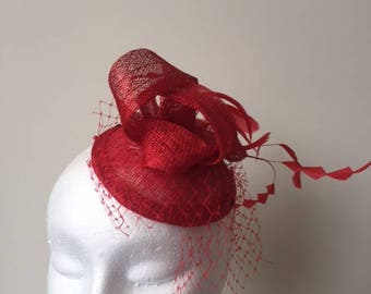 Red sinamay fascinator with netting, loops and feathers!