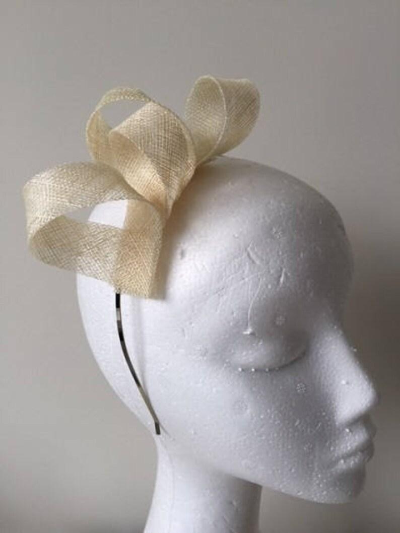 Stunning on! Cream loop fascinator on a metal headband