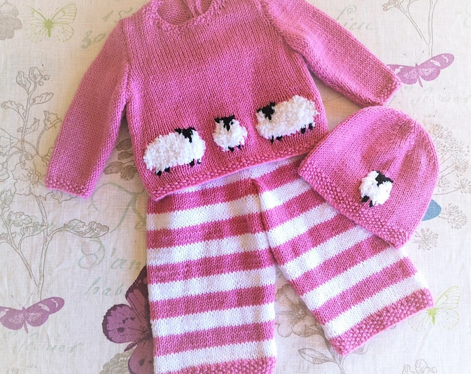 Hand knitted Baby Outfit, Jumper, Hat and Trousers featuring fluffy sheep, knitted in double knitting yarn.  Size birth up to 3 months.