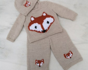 Hand knitted Baby Outfit, Jumper, Hat and Trousers featuring foxes, knitted in double knitting yarn.  Size birth up to 3 months.