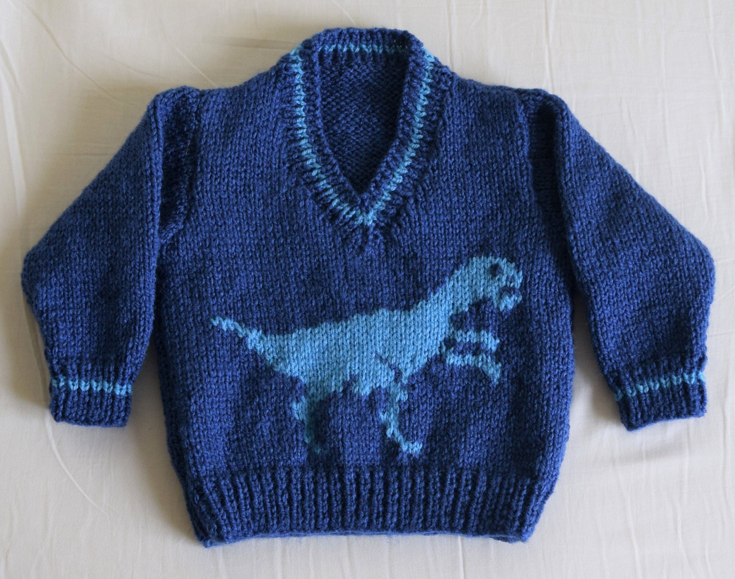17acbe5a48a6a Knitting pattern for boys and girls dinosaur V-neck tops