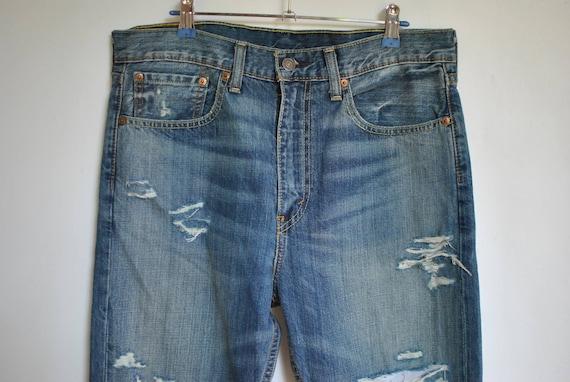 Vintage LEVI'S MEN'S JEANS , ripped jeans , distre