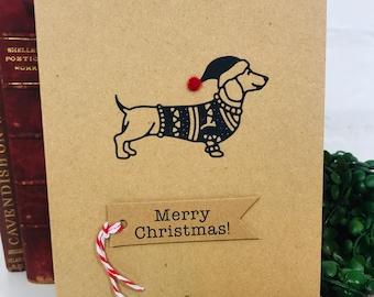 Dachshund, Sausage Dog Handmade Christmas Greetings Card, Wiener Dog paper cut silhouette with red felt pom pom hat Xmmas Card