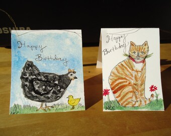 Set of four gift tags for birthdays.