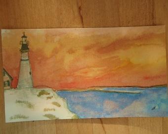 Lighthouse at dusk magnet.