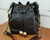 Elegant Classic Black Lambskin Vintage Chanel Drawstring Shoulder Bag Tote with Pouch