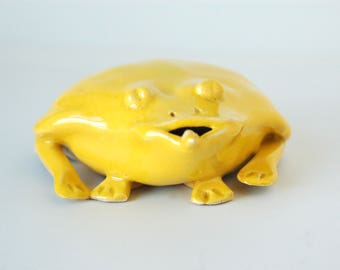 Frog key hider,stoneware clay, bright yellow glaze, and a poem too!
