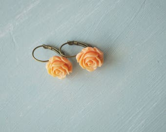 Earrings, peach resin rose brass dangle earrings