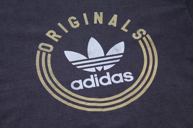 6e475a0bfc62a Adidas t-shirt XL Adidas Originals faded black white and gold Adidas  vintage t-shirt