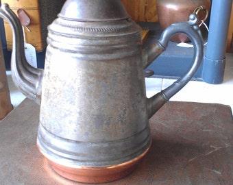 Antique teapot with copper base, pewter handle/spout