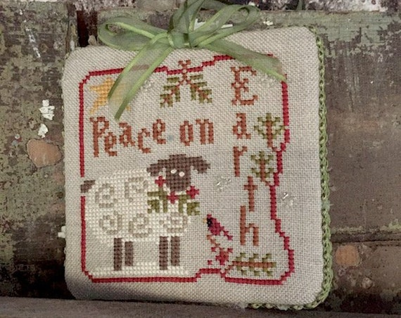 Handmade Finished Store Sample: Cross stitched Ornament Peace on Earth by LHN