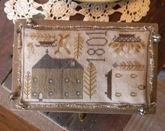 Pattern: Tinsel Towne Cross Stitch created by Notforgotten Farm