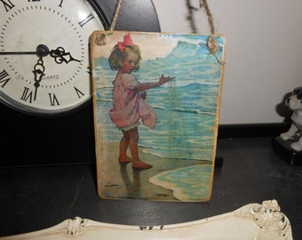 hanging handmade sign tag little girl plays in sea sourced vintage postcard image shabby chic