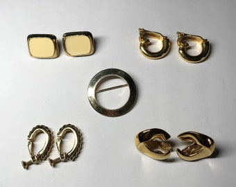 Lot of Costume Jewelry - Four Sets of Earrings and a Circular Brooch