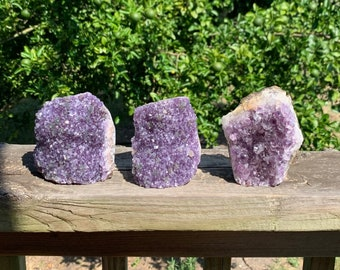 Set of 3--2.8 lb Raw Amethyst clusters With Cut Base and goethite formation