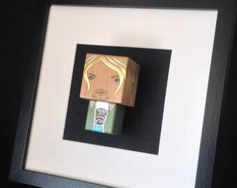 "Figurine ""Kurt Cobain Unplugged"" encadrée ."
