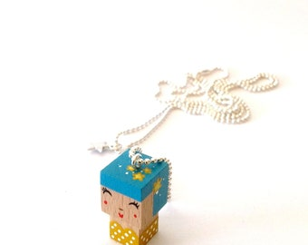 "Pendant cubic figurine ""Pin-up"" blue and yellow ball chain necklace"