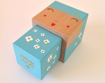 Cubic Kokeshi figurine blue sky with white flowers and Golden - size M