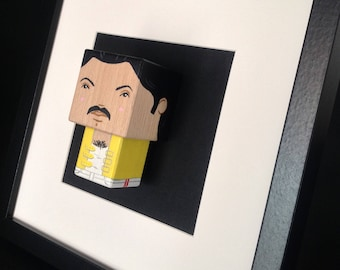 "Framed ""Freddy Mercury"" figurine."