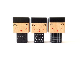 Graphic black and white zirconia Kokeshi figurine