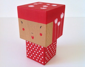 Red zirconia Kokeshi figurine with white flowers and polka dots - size M