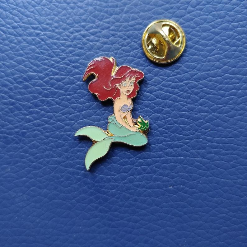 6caba6b7b654a Disney Little Mermaid Ariel pin , Sitting Ariel with flower lapel pin ,  vintage Disney Arthus Bertrand brooch , collectible badge enamel pin