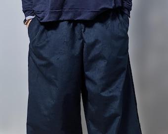 wide, mid-calf length organic corduroy pants with pockets and elastic waistband