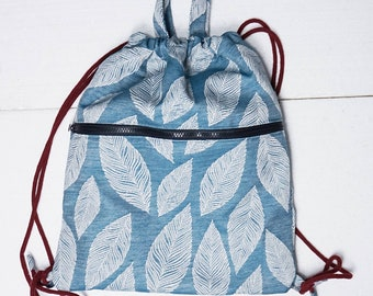 cotton backpack with handles and pocket
