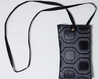 smartphone holder with shoulder strap in upholstered fabric