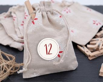 24 fabric bags snowflake advent calendar 10 x 14 cm garland sticker brackets beige/red