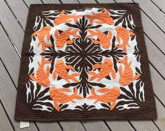 Vintage quilted wall hanging of koi fish in brown/orange/white