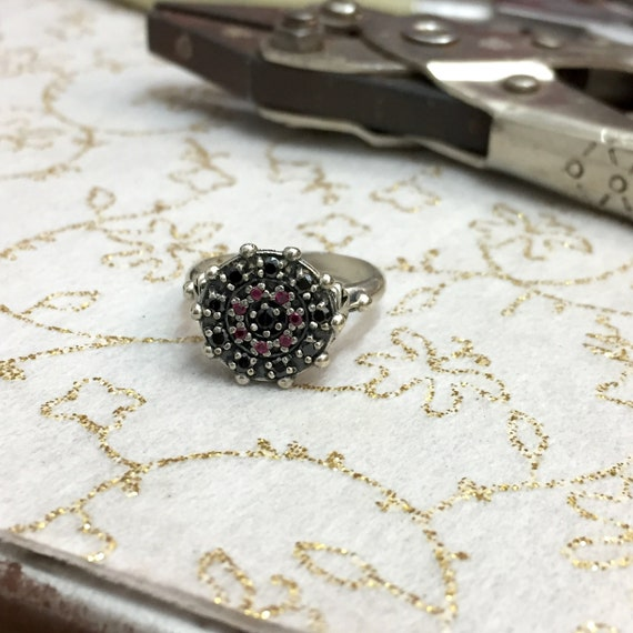 Rubies and a four leaf clover design Sterling Silver ring with Onyx